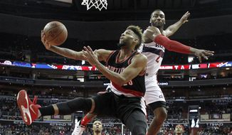 Portland Trail Blazers guard Allen Crabbe (23) shoots in front of Washington Wizards guard John Wall (2) in the second half of an NBA basketball game, Monday, Jan. 18, 2016, in Washington. The Trail Blazers won 108-98. (AP Photo/Alex Brandon)