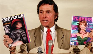 Penthouse publisher and founder Bob Guccione holds up his magazine Penthouse and Playboy magazine at a news conference announcing his anti-censorship campaign at Penthouse magazine offices in New York on June 4, 1986. (Associated Press) **FILE**