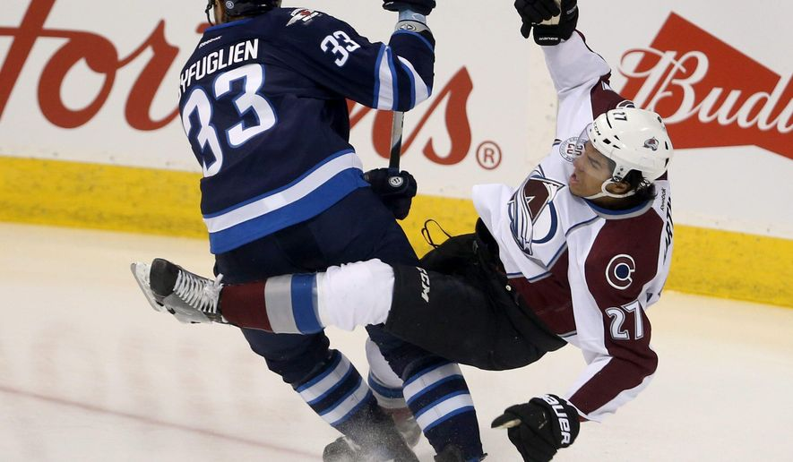 Winnipeg Jets' Dustin Byfuglien (33) hits Colorado Avalanche's Andreaas Martinsen (27) during first period NHL hockey action in Winnipeg, Monday, Jan. 18, 2016. (Trevor Hagan/The Canadian Press via AP)