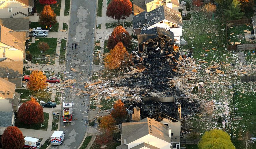 FILE - In this Nov. 11, 2012 file aerial photo, the homes that were leveled and the numerous neighboring homes that were damaged from a massive explosion that sparked a huge fire and killed two people are shown in Indianapolis. Jury selection is scheduled to begin Tuesday, Jan. 19, 2016, in the trial of Bob Leonard, who faces two counts of murder as well as arson and conspiracy charges. (Matt Kryger/The Indianapolis Star via AP)  NO SALES; MANDATORY CREDIT