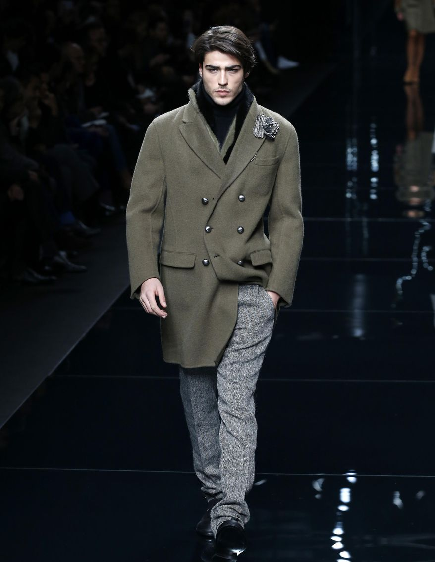 A model wears a creation for Ermanno Scervino men's Fall-Winter 2016-2017 collection, part of the Milan Fashion Week, unveiled in Milan, Italy, Monday, Jan. 18, 2016. (AP Photo/Antonio Calanni)