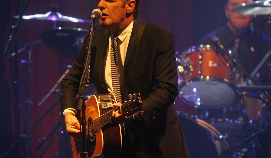 FILE - In this March 20, 2010 file photo, Glenn Frey of the Eagles performs at Muhammad Ali's Celebrity Fight Night XVI in Phoenix, Arizona. The Eagles said band founder Frey died Monday, Jan. 18, 2016, in New York after battling multiple ailments. He was 67. (AP Photo/Ralph Freso, File)