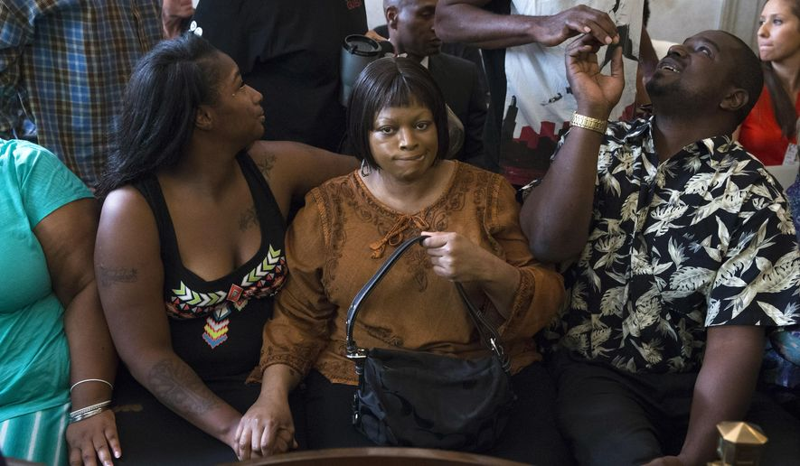 FILE - In a Thursday, July 30, 2015 file photo, Terina Allen, sister of Samuel DuBose, sits with family members as she reacts in the courtroom following the arraignment of former University of Cincinnati police officer Ray Tensing at Hamilton County Courthouse for the shooting death of motorist DuBose, in Cincinnati. It was announced Monday, Jan. 18, 2016, that the family of Samuel DuBose will receive $5.3 million under a settlement with the University of Cincinnati. Tensing, who was indicted and fired from his job, shot and killed Dubose on July 19 and later pleaded not guilty to charges of murder and involuntary manslaughter. (AP Photo/John Minchillo, File)