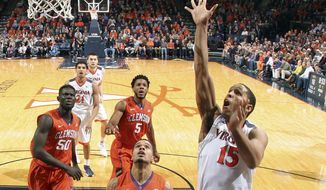 Virginia guard Malcolm Brogdon (15) shoots in front of Clemson guard Avry Holmes (12) during an NCAA college basketball game Tuesday Jan. 19, 2016, in Charlottesville, Va. (AP Photo/Andrew Shurtleff)
