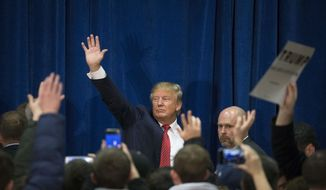 Republican presidential candidate Donald Trump waves to his supporters as he leaves a campaign stop at Concord High School, Monday, Jan. 18, 2016, in Concord, N.H. (AP Photo/John Minchillo)
