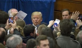 Republican presidential candidate Donald Trump, top center, blows a kiss to a supporter during a campaign stop at Concord High School, Monday, Jan. 18, 2016, in Concord, N.H. (AP Photo/John Minchillo)