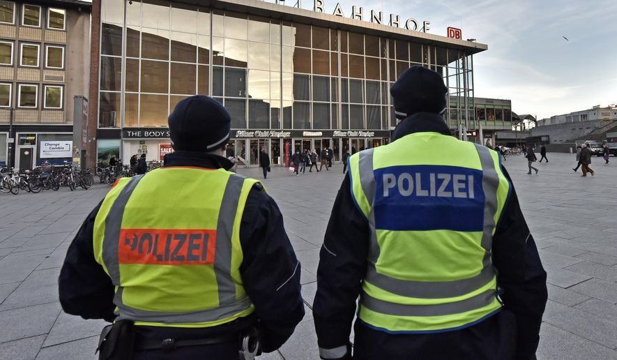 Police patrol in front of the main train station in Cologne, Germany, Monday, Jan. 18, 2016. Authorities in Germany have arrested a 26-year-old Algerian man on suspicion of committing a sexual assault in Cologne during New Year's celebrations. (AP Photo/Martin Meissner)