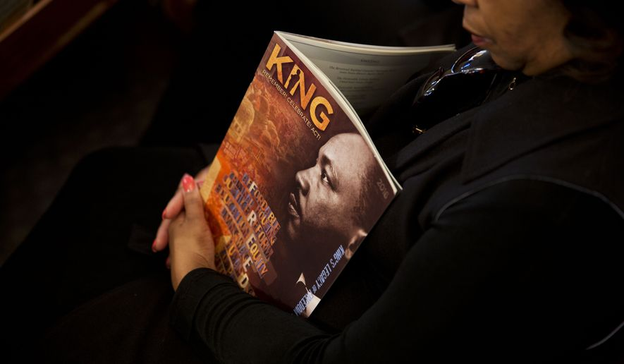 Doris Gray sits with a program during the Rev. Martin Luther King Jr. holiday commemorative service at Ebenezer Baptist Church where King preached, Monday, Jan. 18, 2016, in Atlanta. (AP Photo/David Goldman)