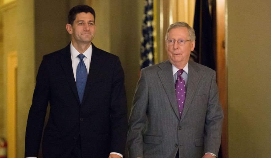 House Speaker Paul Ryan of Wis., left, and Senate Majority Leader Mitch McConnell of Ky. walk in the U.S. Capitol  in Washington. (AP Photo/Andrew Harnik, File)