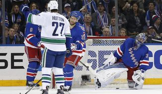 New York Rangers goalie Henrik Lundqvist (30) reacts after Vancouver Canucks  left wing Alex Burrows scored a goal during the second period of an NHL hockey game Tuesday, Jan. 19, 2016, in New York. (AP Photo/Julie Jacobson)
