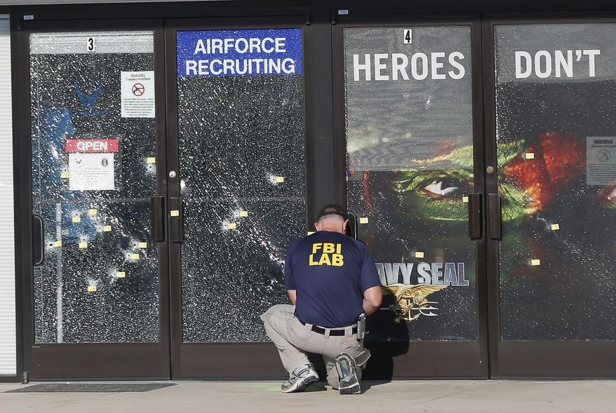 FILE - In this July 17, 2015, file photo, an FBI investigator investigates the scene of a shooting outside a military recruiting center in Chattanooga, Tenn. Violent crime rose across in the country in the first six months of 2015 compared to the same period the year before, according to preliminary data released Tuesday,Jan. 19, 2016, by the FBI. (AP Photo/John Bazemore, File)