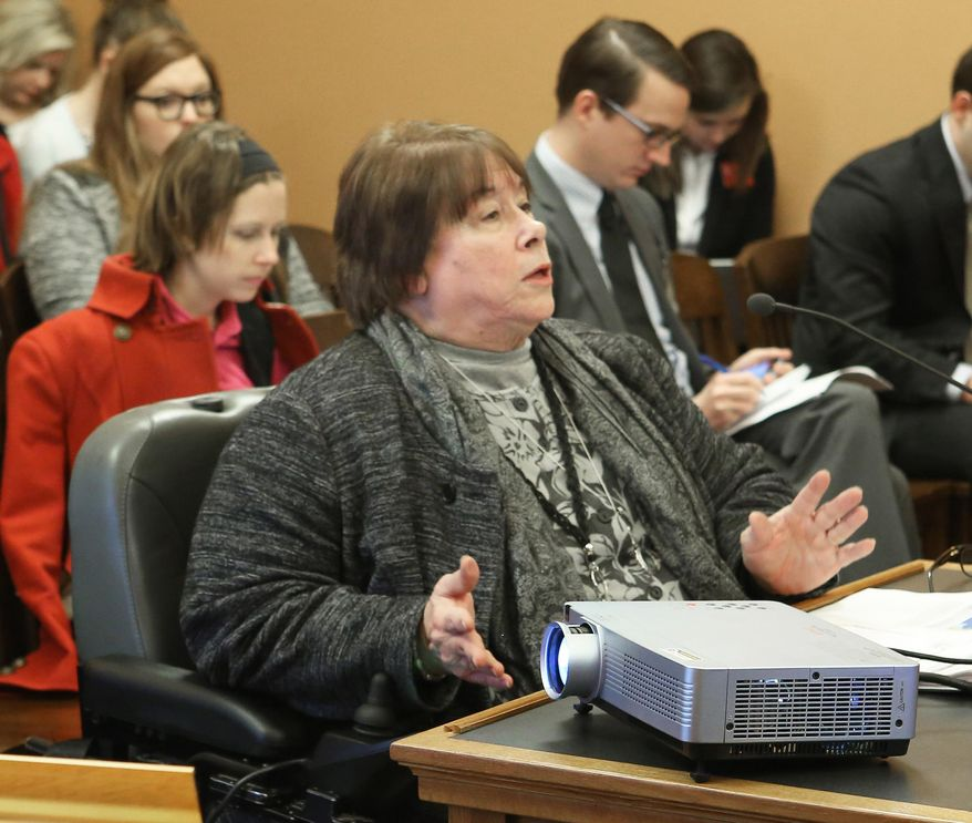 Department for Children and Families Secretary Phyllis Gilmore addresses the House Children and Seniors Committee, Tuesday, Jan. 19, 2016,  in Topeka, Kan, where she spoke to them in a lengthy question-and-answer period where she vehemently pushed back against accusations of discrimination at her agency. (Thad Allton/The Topeka Capital-Journal via AP) MANDATORY CREDIT