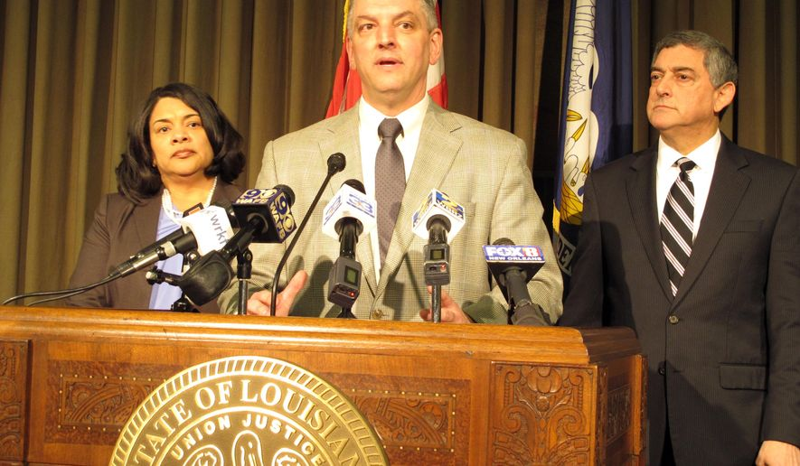 Louisiana Gov. John Bel Edwards, center, unveils his proposals for balancing Louisiana's budget, including a list of tax increases for legislative consideration, during a news conference, Tuesday, Jan. 19, 2016, in Baton Rouge, La. Joining Edwards are Revenue Secretary Kimberly Robinson, left, and Commissioner of Administration Jay Dardenne. (AP Photo/Melinda Deslatte)