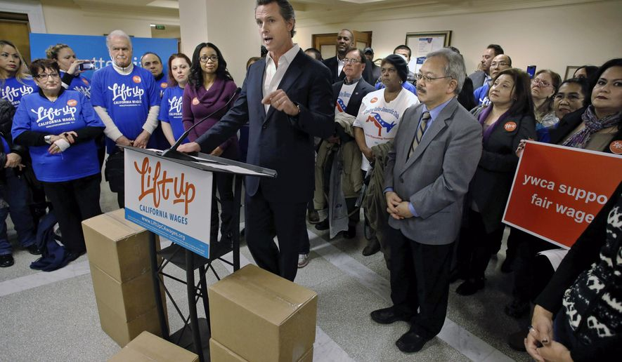 California Lt. Governor Gavin Newsom addresses supporters with Mayor Ed Lee, right, in front of boxes filled with more than 600,000 voter signatures set for delivery to the San Francisco Department of Elections to qualify the Fair Wage Act of 2016 on the ballot, at City Hall in San Francisco , Calif., on Tues. January 19, 2016. A faction of California's largest union began submitting signatures Tuesday for a ballot initiative asking voters to raise California's minimum wage to $15 per hour by 2021, one of two competing proposals vying for the November ballot. (Michael Macor/San Francisco Chronicle via AP)  MANDATORY CREDIT PHOTOG & CHRONICLE; MAGS OUT; NO SALES