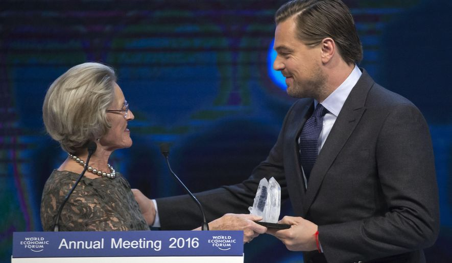 Chairperson and Co-Founder of the Scwab Foundation Hilde Schwab, left, hands over to US Actor Leonardo DiCaprio the Crystal Awards during the World Economic Forum in Davos, Switzerland, Tuesday Jan. 19, 2016. The world's political and business elite are being urged to do more than pay lip service to growing inequalities around the world as they head off for this week's World Economic Forum in the Swiss ski resort of Davos this week. (AP Photo/Michel Euler)