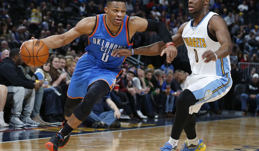 Oklahoma City Thunder guard Russell Westbrook, left, drives to the basket past Denver Nuggets guard Emmanuel Mudiay in the first half of an NBA basketball game Tuesday, Jan. 19, 2016, in Denver. (AP Photo/David Zalubowski)