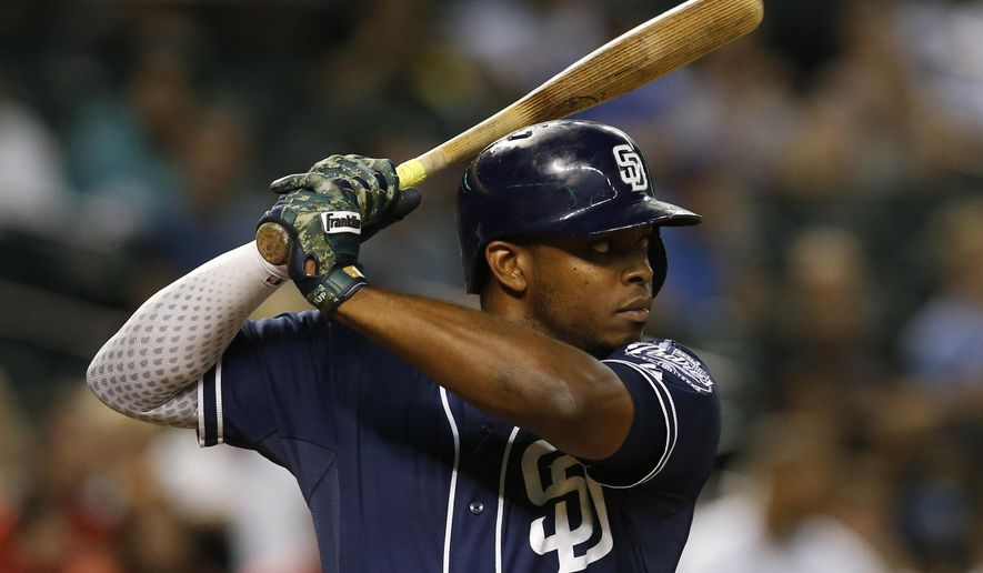 FILE- In this Sept. 15, 2015, file photo, San Diego Padres left fielder Justin Upton looks to hit in the sixth inning of a baseball game against the Arizona Diamondbacks in Phoenix. The Detroit Tigers have agreed to a six-year contract with free-agent outfielder Upton, according to a person with knowledge of the deal. The person spoke Monday, Jan. 18, 2016, on condition of anonymity because the agreement had not been announced.(AP Photo/Rick Scuteri, File)