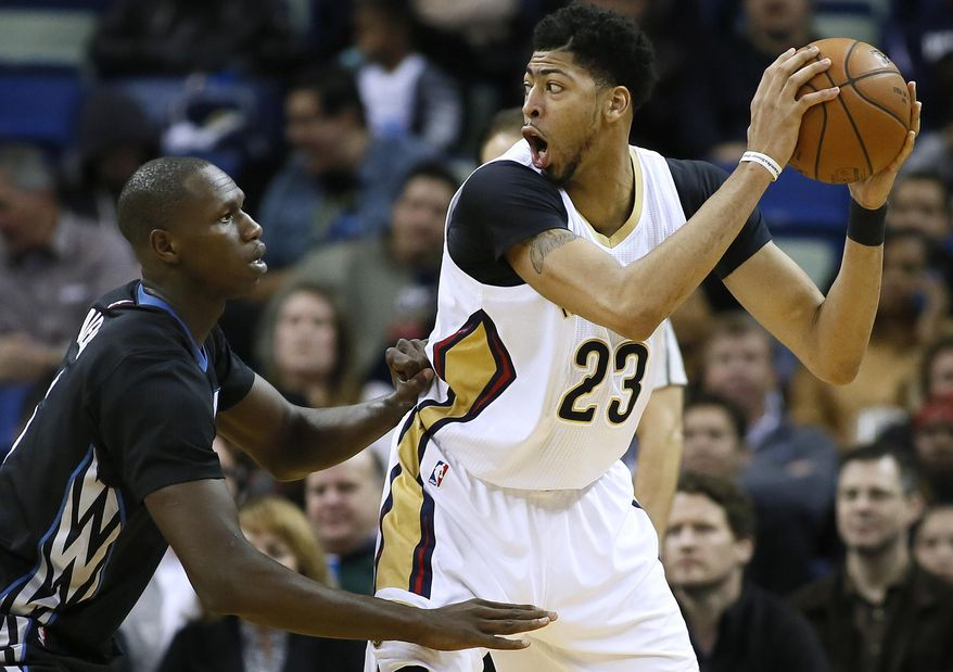 New Orleans Pelicans forward Anthony Davis (23) drives against Minnesota Timberwolves center Gorgui Dieng, left, during the first half of an NBA basketball game Tuesday, Jan. 19, 2016, in New Orleans. (AP Photo/Jonathan Bachman)