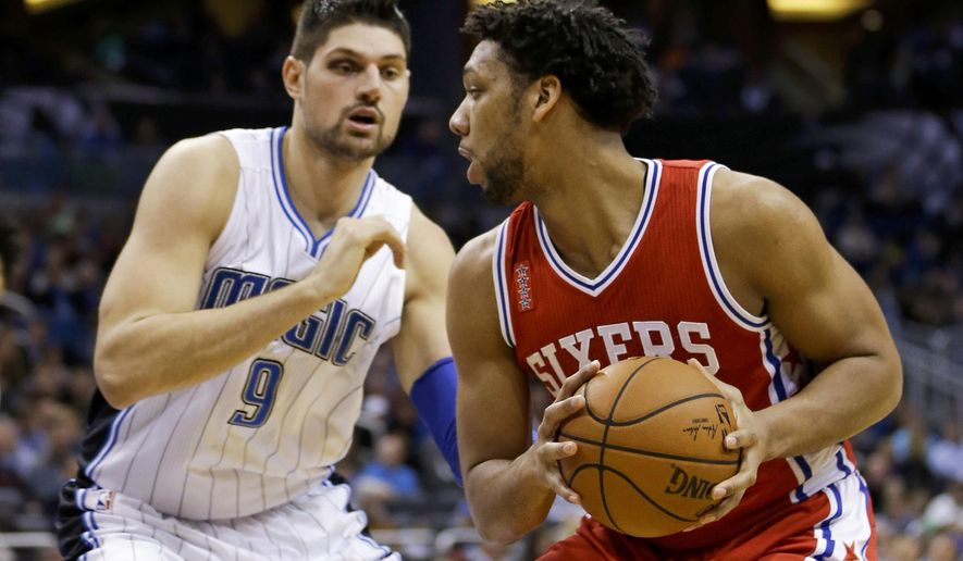 Philadelphia 76ers' Jahlil Okafor, right, looks for a way around Orlando Magic's Nikola Vucevic (9) during the first half of an NBA basketball game, Wednesday, Jan. 20, 2016, in Orlando, Fla. (AP Photo/John Raoux)