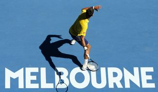Novak Djokovic of Serbia prepares to make a forehand return to Chung Hyeon of South Korea during their first round match at the Australian Open tennis championships in Melbourne, Australia, Monday, Jan. 18, 2016.(AP Photo/Vincent Thian)