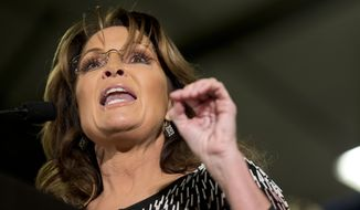 Former Alaska Gov. Sarah Palin endorses Republican presidential candidate Donald Trump during a rally at the Iowa State University in Ames, Iowa, on Jan. 19, 2016. (Associated Press) **FILE**