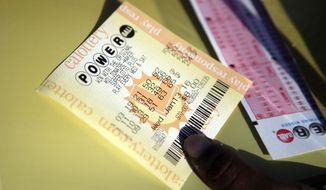 A Powerball ticket is shown Jan. 13 in San Lorenzo, Calif. (Associated Press)