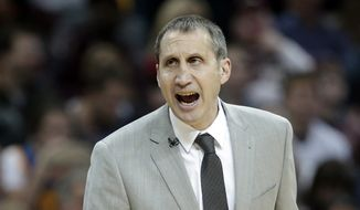 Cleveland Cavaliers head coach David Blatt yells to players in the second half of an NBA basketball game against the Golden State Warriors, Monday, Jan. 18, 2016, in Cleveland. The Warriors won 132-98.  (AP Photo/Tony Dejak)