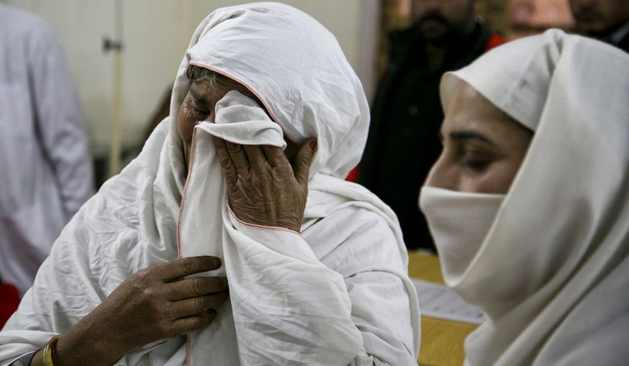 A Pakistani mother cries after her son was injured in an attack in Charsadda town, some 35 kilometers (21 miles) outside the city of Peshawar, Pakistan, Wednesday, Jan. 20, 2016. Gunmen stormed Bacha Khan University named after the founder of an anti-Taliban political party in the country's northwest Wednesday, killing many people, officials said. (AP Photo/B.K. Bangash)