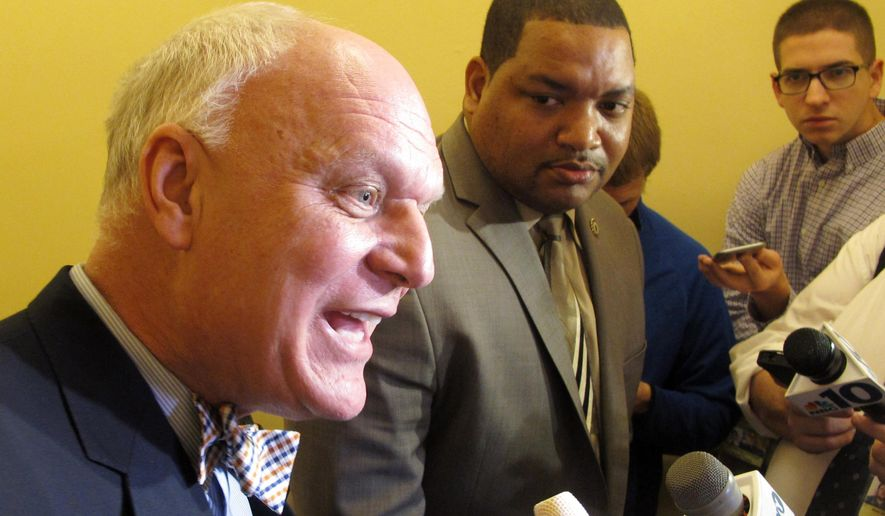 Atlantic City Mayor Don Guardian, left, and City Council President Marty Small, right, speak at a news conference in Trenton, N.J., on Wednesday, Jan. 20, 2016, at which they said the city will consider filing for bankruptcy. Their comments came a day after New Jersey Gov. Chris Christie vetoed an aid package that left the city with a $33.5 million budget gap, among other liabilities. (AP Photo/Wayne Parry)