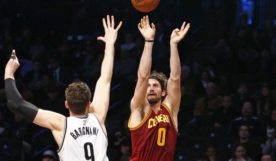 Cleveland Cavaliers forward Kevin Love (0) shoots as Brooklyn Nets center Andrea Bargnani (9) defends in the first half of an NBA basketball game, Wednesday, Jan. 20, 2016, in New York. (AP Photo/Kathy Willens)