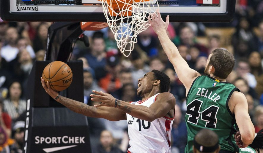 Toronto Raptors guard DeMar DeRozan (10) makes a basket past Boston Celtics centre Tyler Zeller (44) during the first half of an NBA basketball game in Toronto on Wednesday, Jan. 20, 2016. (Nathan Denette/The Canadian Press via AP)
