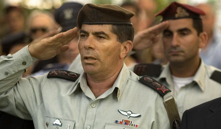 FILE- In this Wednesday, July 8, 2009 file photo, Israeli military chief Lt. Gen. Gabi Ashkenazi salutes during a memorial ceremony for soldiers killed during the second Lebanon War in the military cemetery in Mount Herzl in Jerusalem. On Wednesday, Jan. 20, 2016, Israel's attorney general has dropped a criminal investigation against Ashkenazi a decision that could shake up Israeli politics. (AP Photo/Sebastian Scheiner, File)