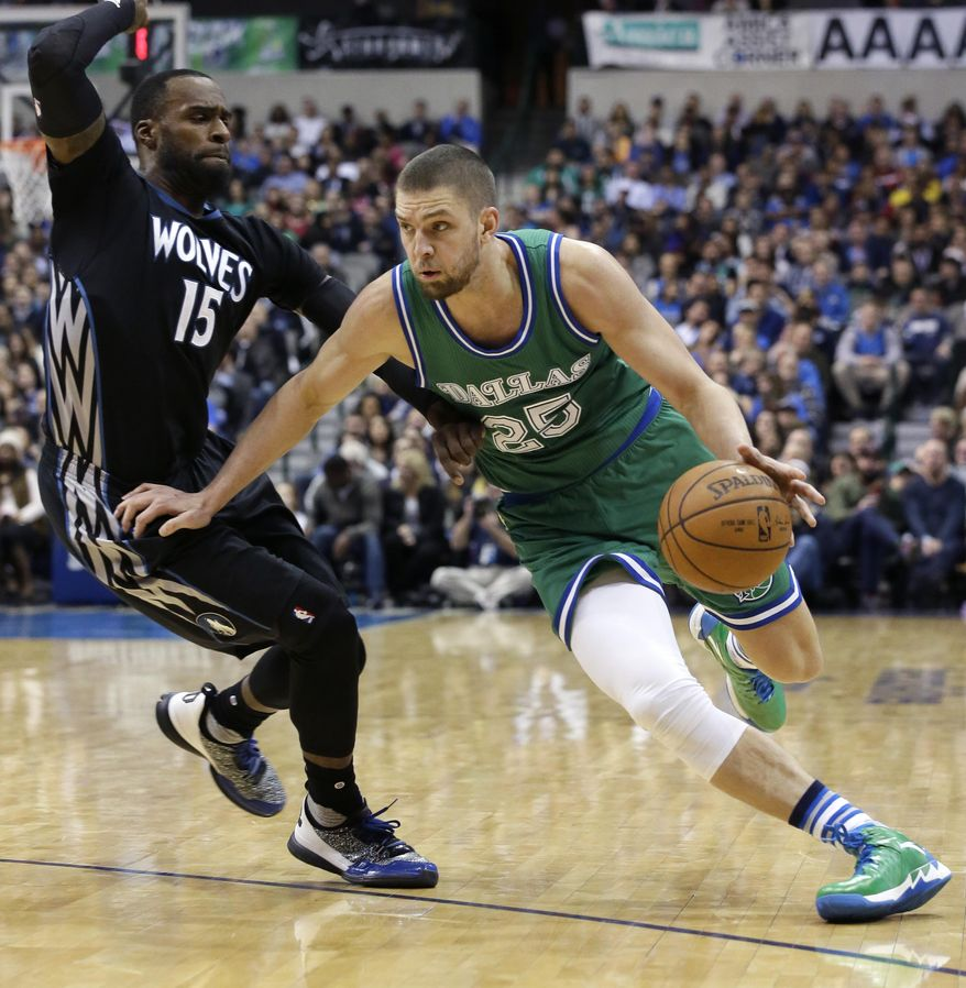 Dallas Mavericks forward Chandler Parsons (25) drives against Minnesota Timberwolves forward Shabazz Muhammad (15) during the second half of an NBA basketball game Wednesday, Jan. 20, 2016, in Dallas. The Mavericks won 106-94 in overtime. (AP Photo/LM Otero)