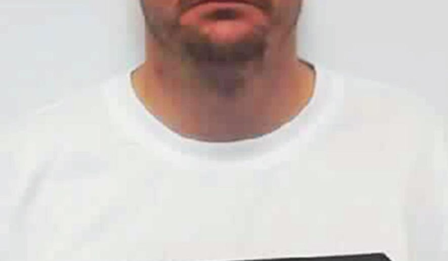 This June 2015 photo provided by the North Dakota Department of Corrections shows Ryan Stensaker who was convicted in December 2014 of conspiracy to commit murder in the shooting death of a northwest North Dakota hobby rancher. Stensaker is serving a life sentence at the North Dakota State Penitentiary in Bismarck and now wants the state Supreme Court to overturn his conviction. Stensaker's attorney told state Supreme Court justices Tuesday, Jan. 19, 2016, that the state's case was based on circumstantial evidence, and that prosecutors never presented a motive. (North Dakota Department of Corrections via AP)