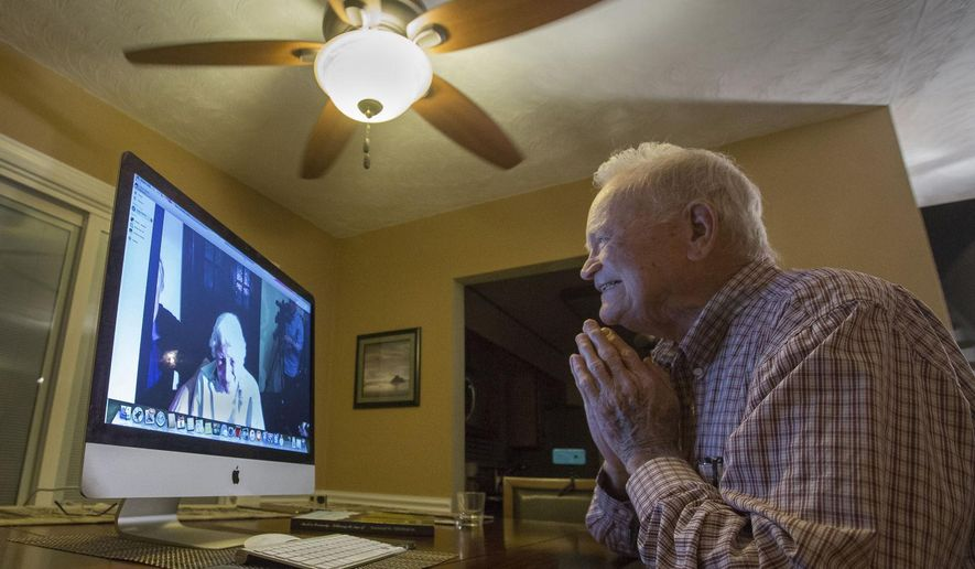 In this photo taken Nov. 6, 2015, Norwood Thomas, 93, talks with Joyce Morris via Skype from his home in Virginia Beach, Va. During World War II, Morris lived in England and was Joyce Durrant, the girlfriend of Thomas, a D-Day paratrooper with the Army's 101st Airborne Division. Morris now lives in Australia. (Bill Tiernan/The Virginian-Pilot via AP)  MAGS OUT; MANDATORY CREDIT