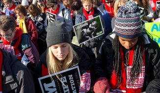 Lauren Sandy (left) and Afure Adah were among the thousands demonstrating at 2015's annual March for Life. Friday's march is expected to draw substantial numbers to Washington, many of them millennials. (Associated Press)