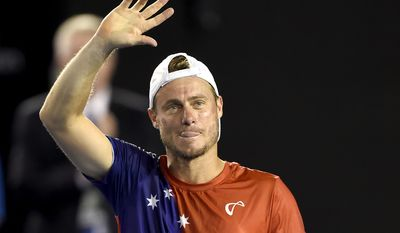 Lleyton Hewitt of Australia waves to the crowd after his second round loss to David Ferrer of Spain at the Australian Open tennis championships in Melbourne, Australia, Thursday, Jan. 21, 2016.(AP Photo/Andrew Brownbill)