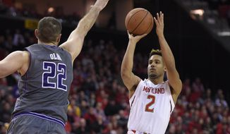 Maryland guard Melo Trimble (2) puts up a shot against Northwestern center Alex Olah (22) during the second half of an NCAA college basketball game, Tuesday, Jan. 19, 2016, in College Park, Md. Maryland won 62-56 in overtime. (AP Photo/Nick Wass)