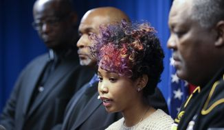 Bridgette Anderson speaks during a news conference in Decatur, Ga., on Jan 7 after the Dekalb County district attorney announced he would seek to indict a police officer who shot and killed her boyfriend, Air Force veteran Anthony Hill. (Associated Press)