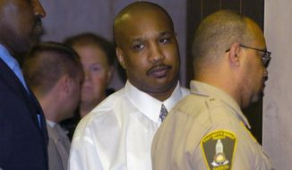 Derrick Todd Lee is escorted from a holding cell into an elevator by members of the East Baton Rouge Sheriff's Office on Sept. 13, 2004, for the start of jury selection in his trial for the murder of Charlotte Murray Pace. (Associated Press)