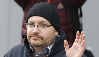 U.S. journalist Jason Rezaian waves as he poses for media people in front of Landstuhl Regional Medical Center in Landstuhl, Germany, Wednesday, Jan. 20, 2016. (AP Photo/Michael Probst) ** FILE **
