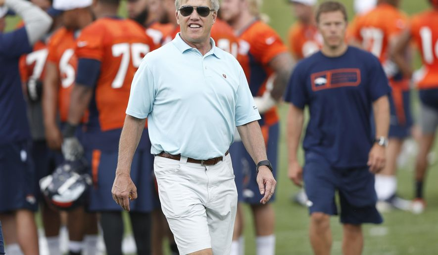 FILE - In this Monday, June 1, 2015, file photo, John Elway, Denver Broncos general manager and executive vice president of football operations, heads off the field after an organized training activity at the NFL football team's headquarters in Englewood, Colo. Elway is helping to prepare the Broncos to host the New England Patriots in the AFC Championship game Sunday in Denver. (AP Photo/David Zalubowski, file)
