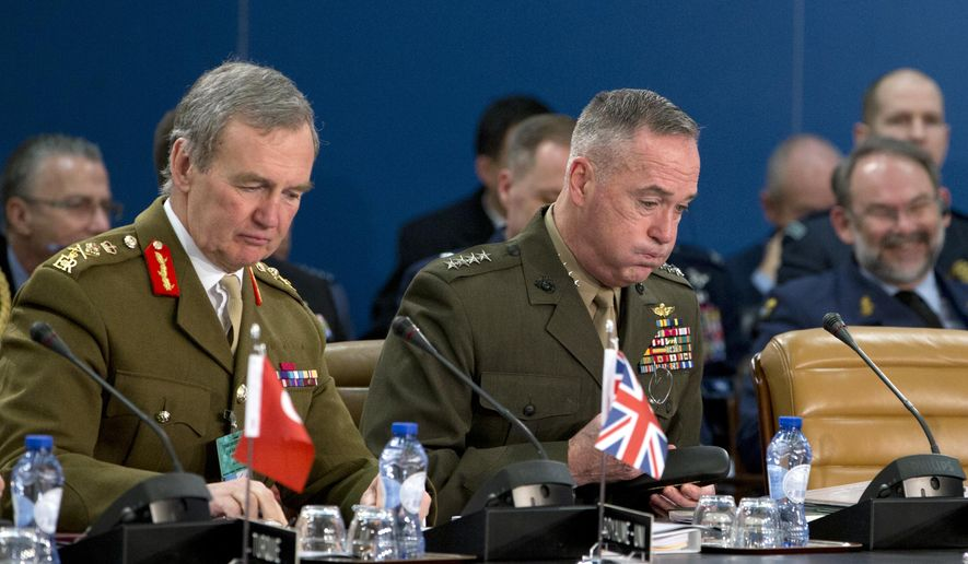 Chairman of the Joint Chiefs of Staff, U.S. Gen. Joseph F. Dunford, center, and British Gen. Sir Nicholas Houghton, second left, participate in a meeting of NATO's Military Committee at NATO headquarters in Brussels on Thursday, Jan. 21, 2016. (AP Photo/Virginia Mayo) ** FILE **