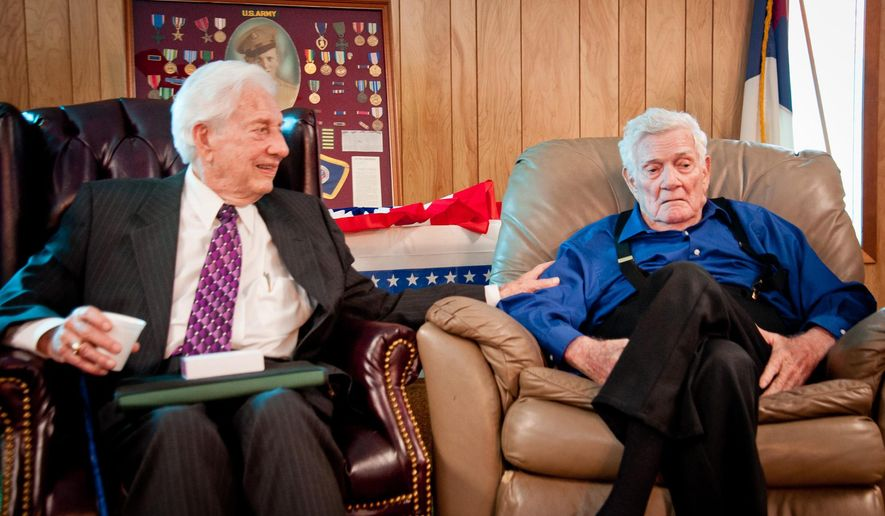 CORRECTS LAST NAME FROM HORNE TO HORN -ADVANCE FOR WEEKEND OF JAN. 22 -This photo taken Jan. 13, 2016, shows Arlie Horn, left, visiting with his friend, fellow WWII veteran Jack Harris of Beckville, Texas, during a ceremony where Horne presented Harris with the Legion of Honor, or Ordre national de la Legion d'honneur, which is France's premier award. Established by French Emperor Napoleon Bonaparte to recognize service to France, the honor is that country's combined equivalent of America's Presidential Medal of Freedom for civilians and military Medal of Honor. (Les Hassell/The News-Journal via AP)