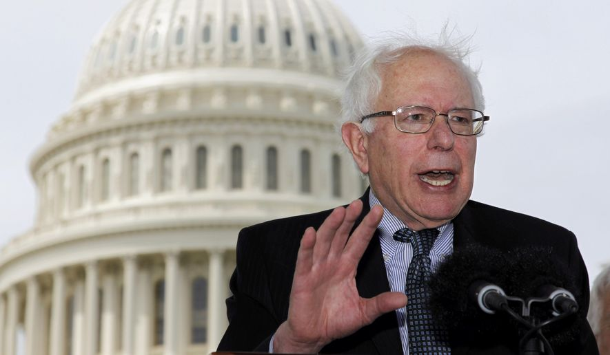 In this May 10, 2011, file photo, Sen. Bernie Sanders, I-Vt., gestures during a news conference on Capitol Hill in Washington to discuss single-payer health care bills in the Senate and House. (AP Photo/Alex Brandon, File)
