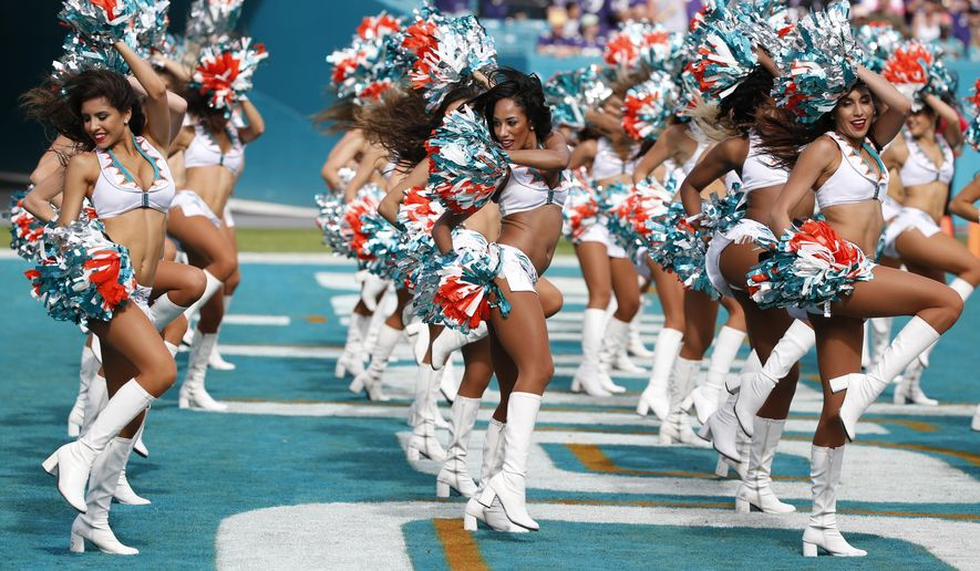 In this Dec. 6, 2015, file photo, the Miami Dolphins cheerleaders perform during the first half of an NFL football game against the Baltimore Ravens, in Miami Gardens, Fla. (AP Photo/Wilfredo Lee, File)