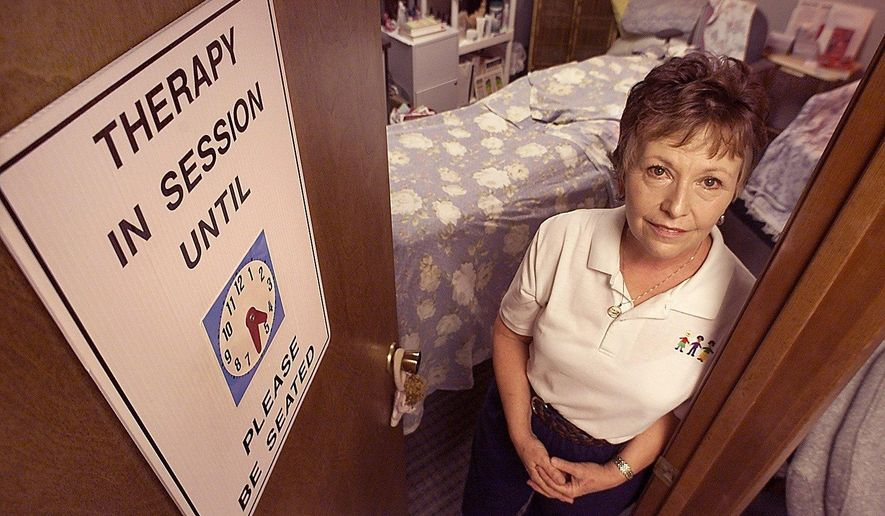 ADVANCE FOR USE MONDAY, JAN. 25 - In this photo taken Sept. 13, 2002, Diana R. Simone, a massage therapist, poses in her office in south Fort Worth. Simone is credited with coming up with the idea for the Amber alert, after the 1996 abduction and murder of Amber Hagerman in Arlington, Texas. (Ron T. Ennis/Star-Telegram via AP)  MAGS OUT; (FORT WORTH WEEKLY, 360 WEST); INTERNET OUT; MANDATORY CREDIT