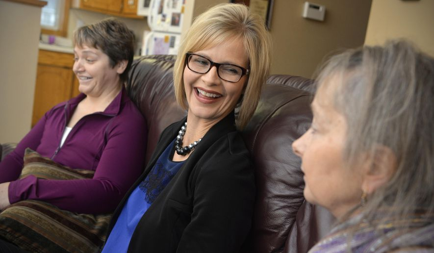 FOR RELEASE MONDAY, JANUARY 25, 2016, AT 12:01 A.M. CST.-Tammy Moore, center, talks with sisters, Joan Willenbring, right, and Pam Hansen at Hansen's St. Joseph, Minn. home Nov. 17, 2015 about their decisions to get mastectomies and hysterectomies after a history of breast and ovarian cancer in their family. (Kimm Anderson/The St. Cloud Times via AP)