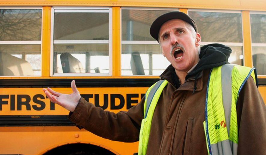 ADVANCE FOR THE WEEKEND OF JAN. 23 - In this undated photo, bus driver Philip Bologna performs for a photo his singing talent beside a school bus he drives in Rochester, Minn. Bologna, 63, a former opera singer, uses his talent to reach students on a bus he drives for Rochester schools. (Germaine Langer Neumann/The Rochester Post-Bulletin via AP) MANDATORY CREDIT