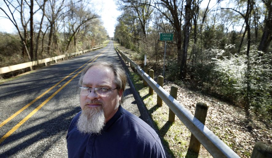 "ADVANCE FOR USE SUNDAY, JAN. 24 - In this photo taken Tuesday, Jan. 12, 2016, E.R. Bills, authored of the book ""Slocum Massacre,""  poses for a portrait next to Sadler Creek in Slocum, Texas. (Vernon Bryant/The Dallas Morning News via AP) MANDATORY CREDIT"